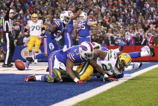 Green Bay Packers running back Eddie Lacy (27) is tackled by Buffalo Bills' Nigel Bradham (53) in the end zone for a safety during the second half of an NFL football game Sunday, Dec. 14, 2014, in Orchard Park, N.Y. The Bills won the game 21-13. (AP Photo/Gary Wiepert) ORG XMIT: NYFF125 Photo: Gary Wiepert / FR170498 AP