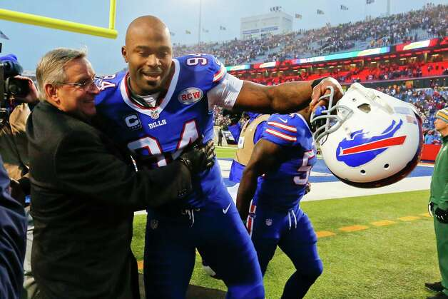 Buffalo Bills Owner Terry Pegula, left, hugs defensive end Mario Williams after an NFL football game against the Green Bay Packers, Sunday, Dec. 14, 2014, in Orchard Park, N.Y. The Bills won the game 21-13. (AP Photo/Bill Wippert) ORG XMIT: NYFF126 Photo: Bill Wippert / FR170745 AP