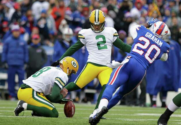 Green Bay Packers kicker Mason Crosby (2) boots a field goal during the first half of an NFL football game against the Buffalo Bills, Sunday, Dec. 14, 2014, in Orchard Park, N.Y. (AP Photo/Bill Wippert) ORG XMIT: NYFF108 Photo: Bill Wippert / FR170745 AP