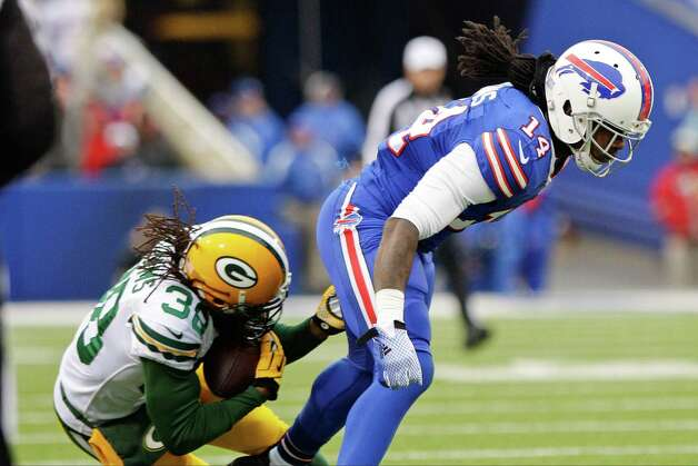 Green Bay Packers' Tramon Williams (38) intercepts a pass to Buffalo Bills wide receiver Sammy Watkins (14) during the first half of an NFL football game Sunday, Dec. 14, 2014, in Orchard Park, N.Y. (AP Photo/Bill Wippert) ORG XMIT: NYFF114 Photo: Bill Wippert / FR170745 AP