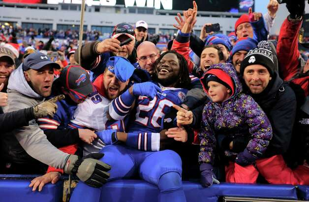 Buffalo Bills runningback  Boobie Dixon celebrates with the fans after a 21-13 victory over the Green Bay Packers in the NFL football game at Ralph WIlson Stadium on Sunday, Dec. 14, 2014  in Orchard Park, NY. (AP Photo/The Buffalo News, Harry Scull, Jr.)  TV OUT; MAGS OUT; MANDATORY CREDIT; BATAVIA DAILY NEWS OUT; DUNKIRK OBSERVER OUT; JAMESTOWN POST-JOURNAL OUT; LOCKPORT UNION-SUN JOURNAL OUT; NIAGARA GAZETTE OUT; OLEAN TIMES-HERALD OUT; SALAMANCA PRESS OUT; TONAWANDA NEWS OUT       ORG XMIT: NYBUE107 Photo: Harry Scull Jr. / The Buffalo News