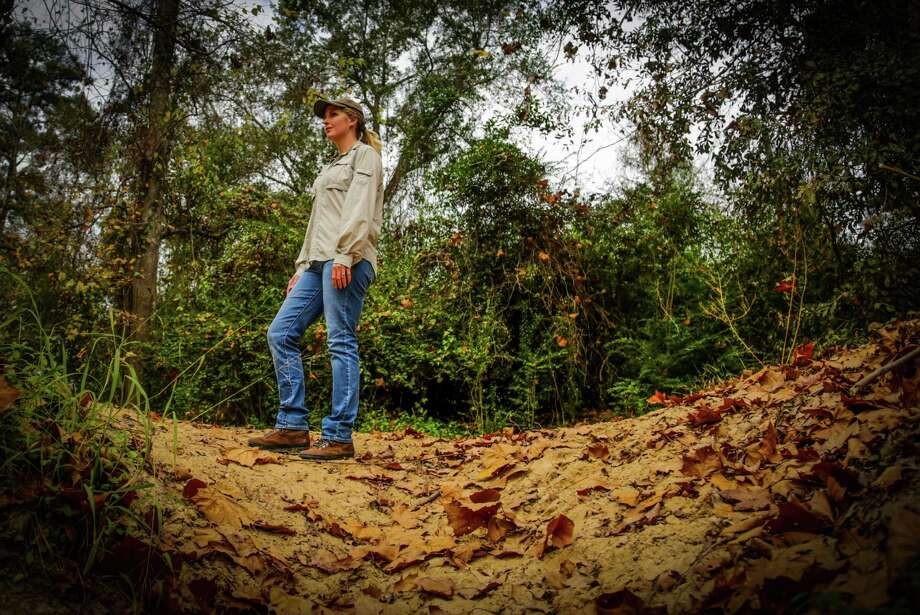 Stephanie Prosser, a conservation lands biologist at Bayou Land Conservancy, walks the trails of the Spring Creek Greenway last week. Photo: Billy Smith II, Staff / © 2014 Houston Chronicle