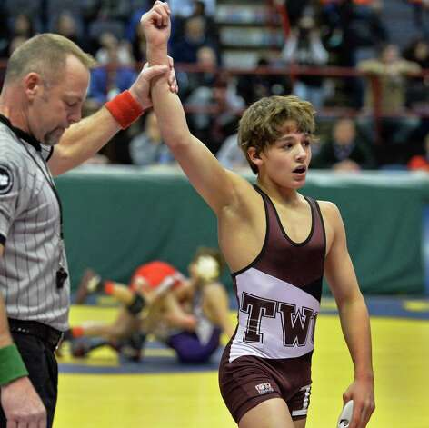 Burnt Hills wrestler Christian Gramuglia has his hand raised in victory after defeating Dylan Avena of Clarence High in a first round 99 lb. match at the NY State wrestling tournament at the Times Union Center Friday Feb. 28, 2014, in Albany, NY.  (John Carl D'Annibale / Times Union) Photo: John Carl D'Annibale / 00025917A