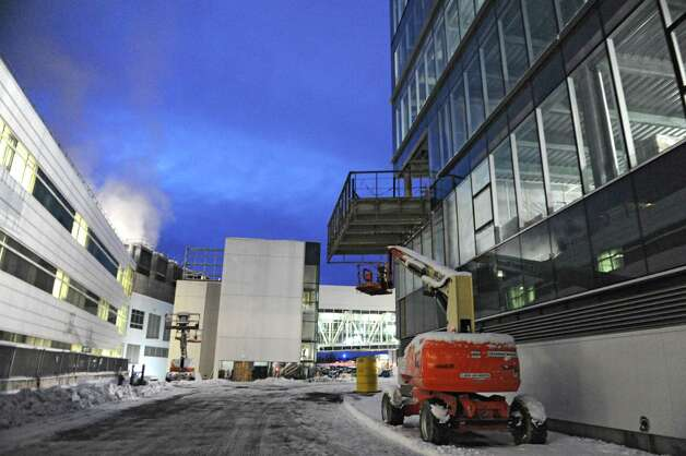 Exterior of the new ZEN building, on right, under construction at the College of Nanoscale Science and Engineering on Thursday, Dec. 11, 2014 in Albany, N.Y. (Lori Van Buren / Times Union) Photo: Lori Van Buren / 00029814A