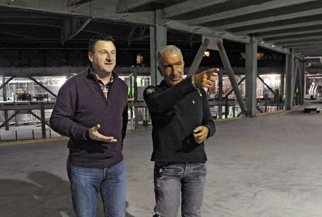Frank Poore, CEO of CommerceHub, left, and Alain Kaloyeros, Senior Vice President and Chief Executive Officer, College of Nanoscale Science and Engineering, take a tour of the new ZEN building under construction at  CNSE on Thursday, Dec. 11, 2014 in Albany, N.Y. This is the top floor where the company CommerceHub will be located. (Lori Van Buren / Times Union) Photo: Lori Van Buren / 00029814A