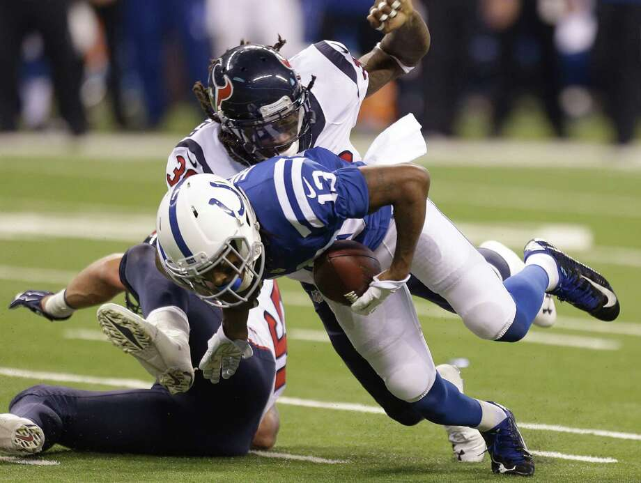 Colts wide receiver T.Y. Hilton (13) found the going tougher than usual against safety D.J. Swearinger and the Texans' defense during Sunday's game. Photo: Brett Coomer, Staff / © 2014  Houston Chronicle