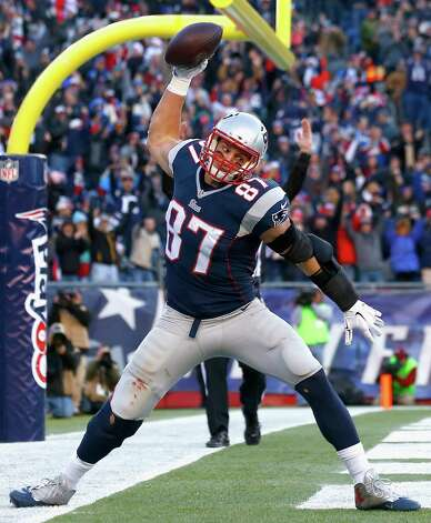 FOXBORO, MA - DECEMBER 14:  Rob Gronkowski #87 of the New England Patriots reacts after catching a touchdown pass during the third quarter against the Miami Dolphins at Gillette Stadium on December 14, 2014 in Foxboro, Massachusetts.  (Photo by Jared Wickerham/Getty Images) ORG XMIT: 507867889 Photo: Jared Wickerham / 2014 Getty Images