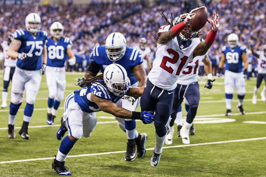 Safety Kendrick Lewis provides the Texans with their only touchdown of the day by diving past Colts running back Trent Richardson to finish off a 27-yard interception return. Photo: Brett Coomer, Staff / © 2014  Houston Chronicle