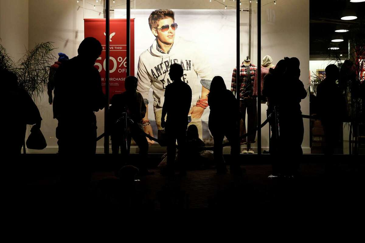 People wait outside the American Eagle store for it to open at the Citadel Outlets in Los Angeles. Teen retailers have been losing favor with their core demographic since the recession.