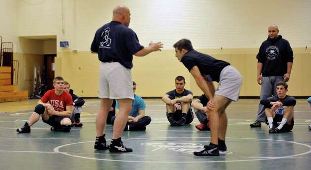 Olympic wrestler, Mark Schultz, left, talks about wrestling  during a Journeymen Wrestling clinic at Colonie High School on Sunday, Dec. 14, 2014, in Colonie, N.Y.  (Paul Buckowski / Times Union) Photo: Paul Buckowski / 00029845A