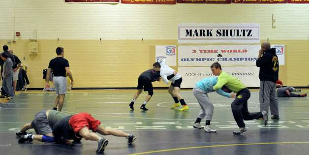 Wrestlers run through drills during a Journeymen Wrestling clinic at Colonie High School on Sunday, Dec. 14, 2014, in Colonie, N.Y.  Olympic wrestler, Mark Schultz, was teaching at the clinic.  (Paul Buckowski / Times Union) Photo: Paul Buckowski / 00029845A