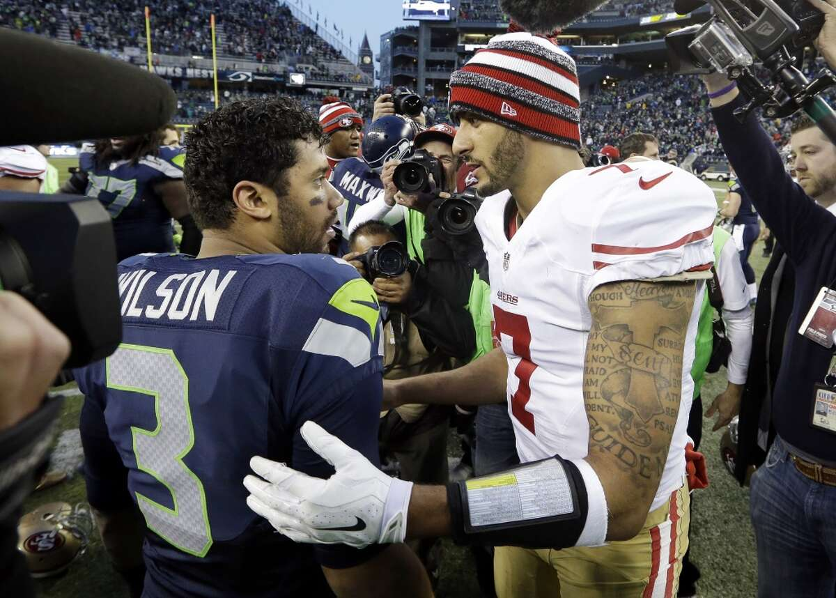 """Seattle Seahawks quarterback Russell Wilson said Colin Kaepernick """"definitely"""" should still be playing in the NFL, and added that he could even see the former 49ers star on the Seahawks' roster as his backup."""
