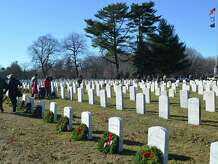 More than 950 graves at Spring Grove Veterans Cemetery were decorated with wreaths Saturday as part of the annual Wreaths Across America project.