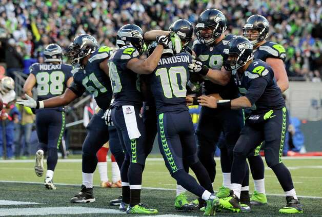 Seattle Seahawks wide receiver Paul Richardson (10) is mobbed by teammates after he scored a touchdown against the San Francisco 49ers in the second half of an NFL football game, Sunday, Dec. 14, 2014, in Seattle. It was Richardson's first NFL touchdown. (AP Photo/John Froschauer) ORG XMIT: SEA139 Photo: John Froschauer / FR74207 AP