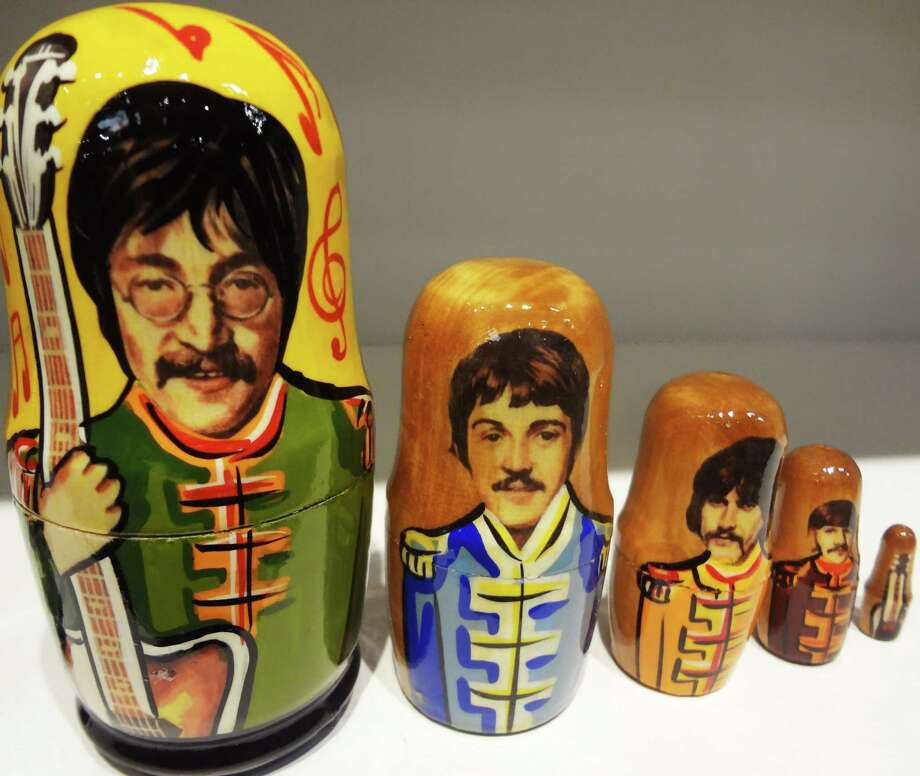 Handmade in Russia, Sgt. Pepper-themed Beatles stacking dolls are available at the Institute of Texan Cultures gift shop for $39.99. Photo: Photo By Steve Bennett