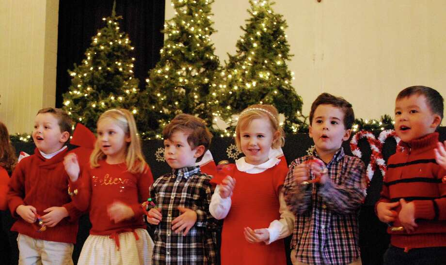 Youngsters at St. John Preschool herald the holidays at the school's recent Christmas sing-along. Photo: Contributed Photo / Darien News