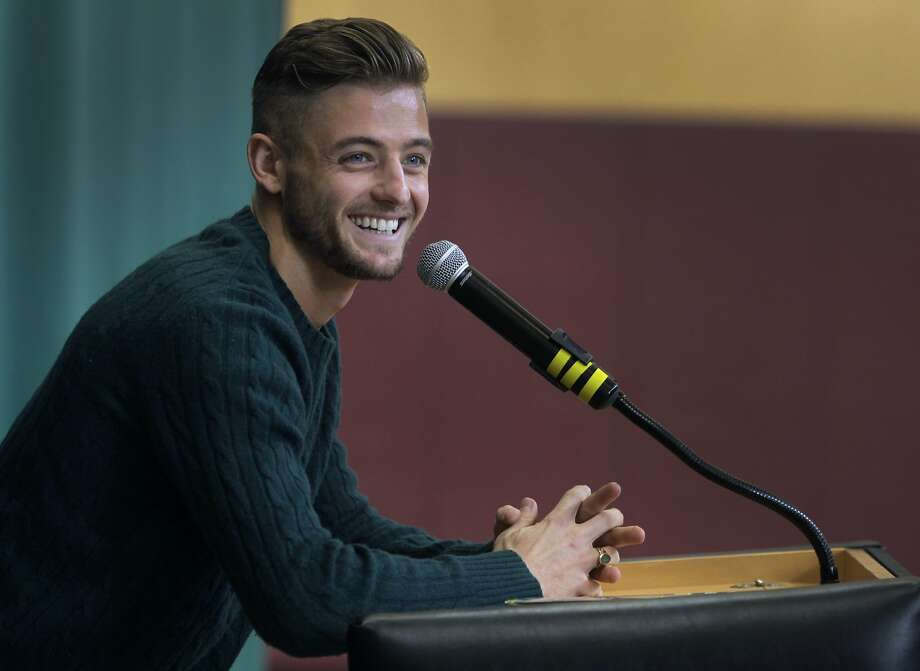 "MLS soccer star Robbie Rogers talks to students about his new book, ""Coming Out to Play"", at the Athenian School in Danville, Calif. on Wednesday, Dec. 10, 2014, and about his decision to come out as openly gay while still playing for the Los Angeles Galaxy. Photo: Paul Chinn, The Chronicle"