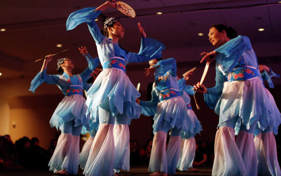 The colorful and lively Ah-Lan dance group performs at the American Chinese Cultural and Art Association's Christmas fundraiser at the Chinatown Hilton. Photo: Scott Strazzante / The Chronicle / ONLINE_YES