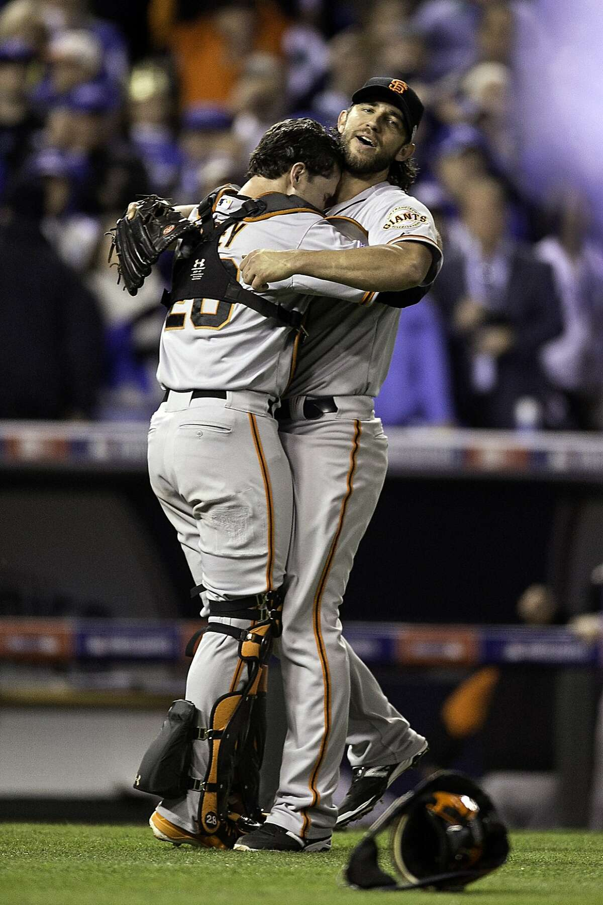 San Francisco Giants' Madison Bumgarner and Buster Posey celebrate after Game 7 of the World Series at Kauffman Stadium on Wednesday, Oct. 29, 2014 in Kansas City, Mo.