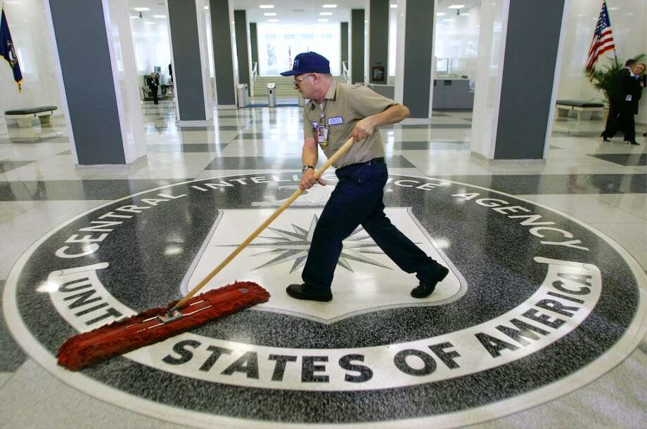 Take a look back at some of the strangest complaints about the CIA cafeteria.In this March 3, 2005 file photo, a workman slides a dustmop over the floor at the Central Intelligence Agency headquarters in Langley, Va. Photo: J. Scott Applewhite, Associated Press