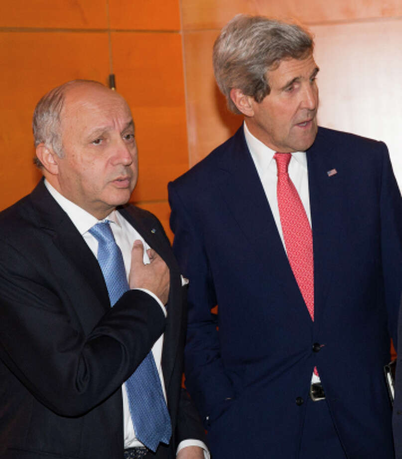 French Foreign Minister Laurent Fabius and Secretary of State John Kerry. Photo: Evan Vucci / Associated Press / AP Pool