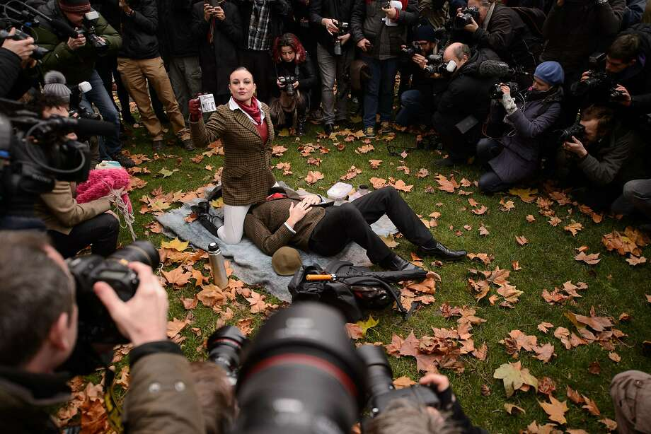 """TOPSHOTS Demonstrators take part in a mass """"face-sitting protest"""" outside the Houses of Parliament in central London on December 12, 2014, as they protest against changes to pornography regulations. AFP PHOTO / LEON NEALLEON NEAL/AFP/Getty Images Photo: Leon Neal, AFP/Getty Images"""