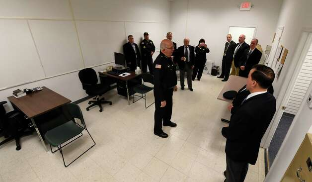 Saratoga County Sheriff Mike Zurlo, center, officially opens the satellite sheriff's office at the Wilton Mall Monday morning Dec. 15, 2014 in Wilton, N.Y. Joining the festivities were a cross section of county and state dignitaries.  (Skip Dickstein/Times Union) Photo: SKIP DICKSTEIN / 00029547A
