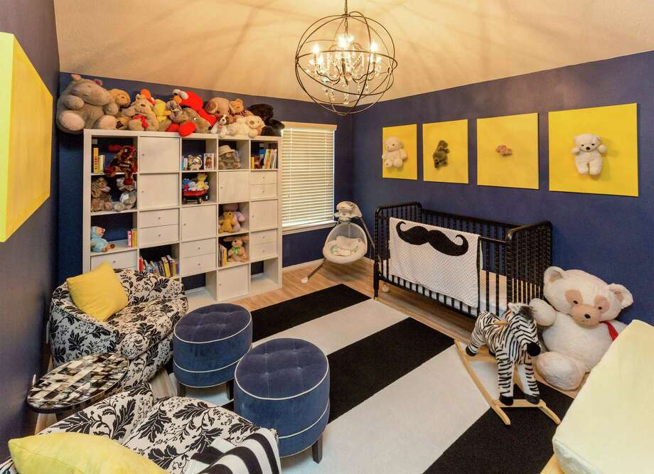 The couple's nursery for their son, Isaac, is painted a dark navy blue, a shade father Yano Garcia believes Isaac will fully appreciate when he's older. Photo: Craig Hartley, Freelance / Copyright: Craig H. Hartley