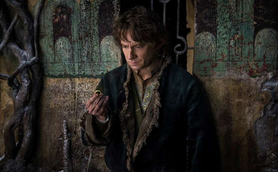 "MARTIN FREEMAN as Bilbo in the fantasy adventure ""THE HOBBIT: THE BATTLE OF THE FIVE ARMIES,"" a production of New Line Cinema and Metro-Goldwyn-Mayer Pictures (MGM), released by Warner Bros. Pictures and MGM. Photo: Mark Pokorny, Photographer / (c) 2013 Warner Bros. Entertainment Inc. and Metro-Goldwyn-Mayer Pictures Inc."