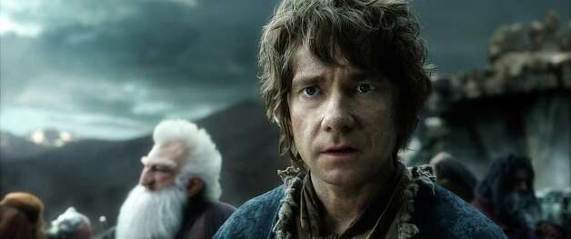 """The Hobbit: The Battle of the Five ArmiesReview: Hobbit concludes, at lastTwo-and-a-half stars Now that it's over, finally, we can see that all three parts of """"The Hobbit"""" told a very simple story: Bilbo, a hobbit, is recruited by dwarves to help them steal treasure from a dragon. They do, but then end up in a big battle with scary, evil Orcs. That's it. That's what it took three movies and eight hours of screen time to tell. Photo: HO / Warner Bros. Entertainment"""