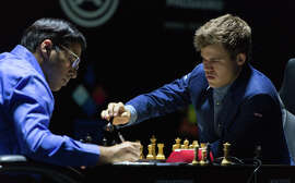 Magnus Carlsen (right) and Vishwanathan Anand face off at the World Chess Championship Match in Sochi, Russia.