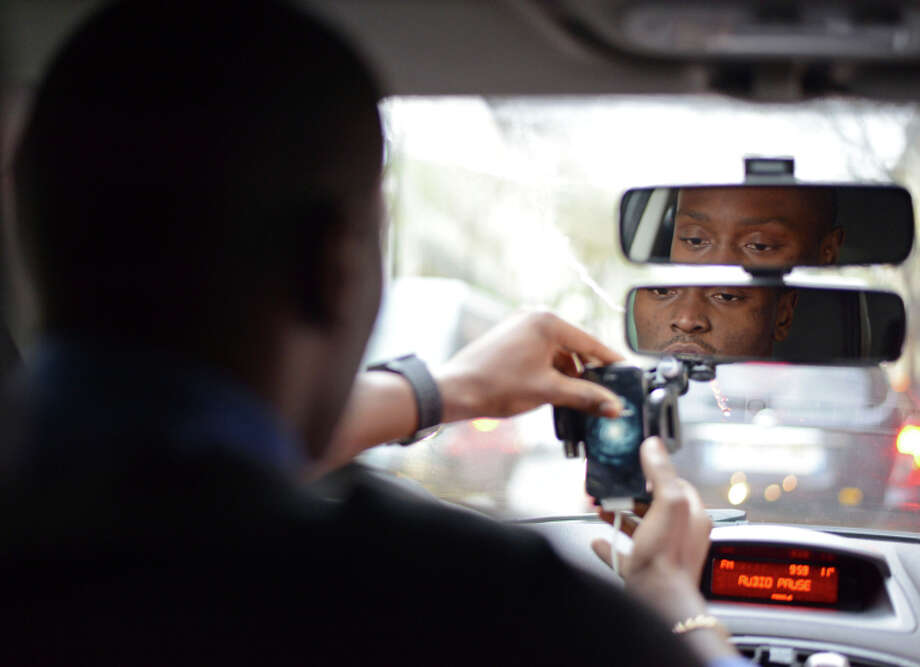 UberPop drivers like Anthony Loussala- Dubreas, 24, soon will be banned in France. Photo: Bastien Inzaurralde / Associated Press / AP