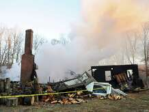 Fire leveled a house on Shortwoods Road, in New Fairfield, Conn. Monday afternoon, Dec. 15, 2014.