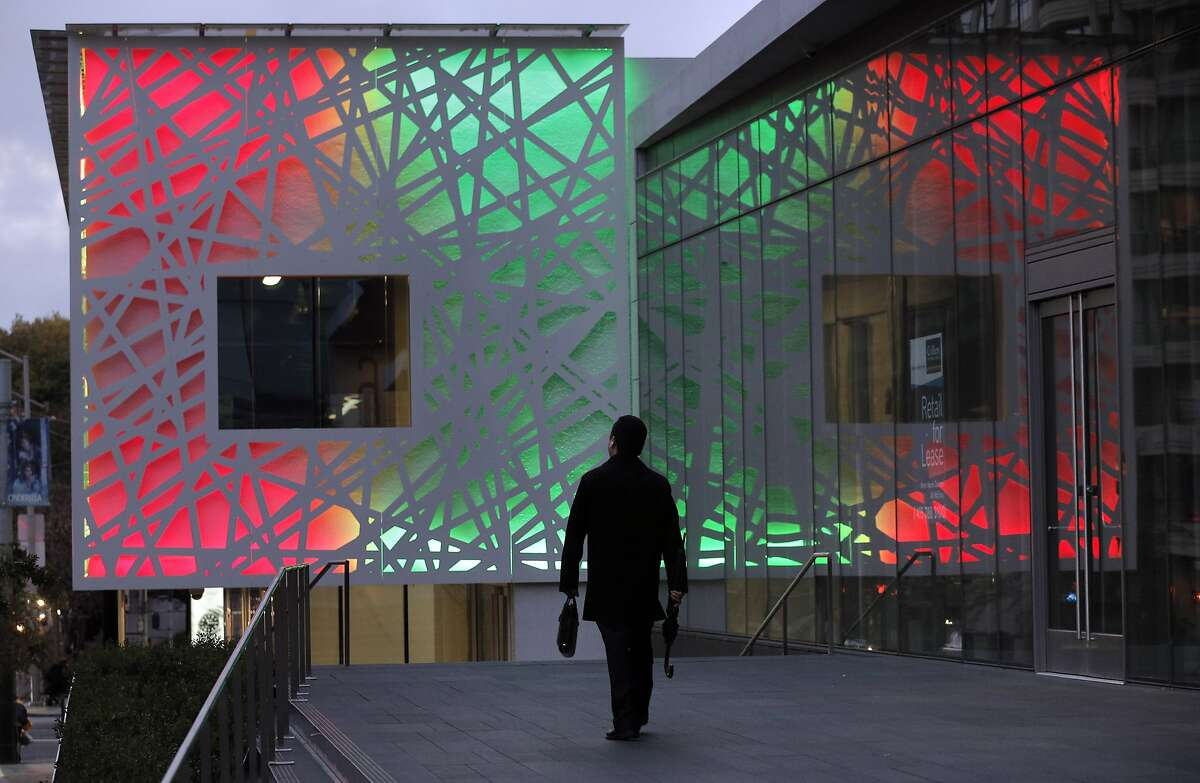 A man walks toward the new building at the northeast corner of Third and Folsom Streets in San Francisco, Calif., on Wednesday, November 3, 2014. The building is quite a departure from the surrounding area as it was lighted for the first time.