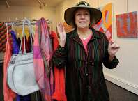 Christine Irvin has been president of the Stamford Art Association for the past decade. The group spnsors eight shows each year in its Franklin St. Townhouse Gallery. Here she models a hat designed for women recovering from breast cancer at a special show she collaborated on with Laura Kamen last fall.