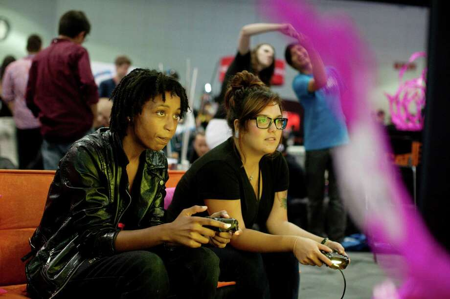 Today's video gamers are playing in better-than- real worlds where they are invincible and amass wealth with little effort and are left with little tolerance for the day-to-day grind of real life. Photo: EMILY BERL /New York Times / NYTNS
