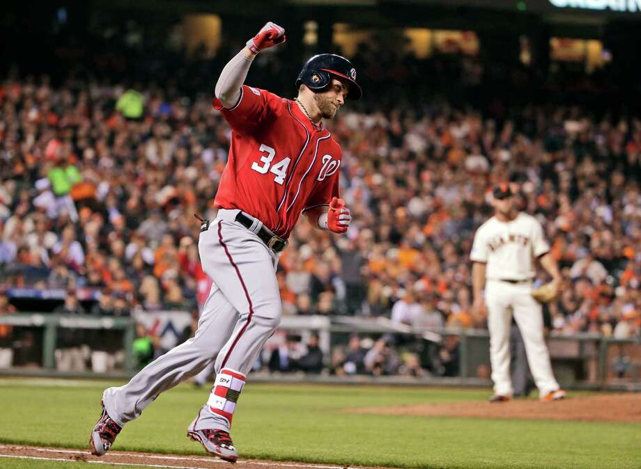 FILE - In this Oct. 7, 2014 file photo, Washington Nationals Bryce Harper celebrates after scoring on a solo home run in the seventh inning against the San Francisco Giants during Game 4 of baseball's NL Division Series in San Francisco. A person familiar with the agreement says Harper and the Washington Nationals have come to terms on a $7.5 million, two-year contract, avoiding a grievance hearing. Harper gets a $2.5 million salary in 2015, and $5 million in 2016. (AP Photo/Marcio Jose Sanchez, File) Photo: Marcio Jose Sanchez, STF / AP