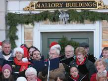 Mystic Seaport's annual free day is Sunday, Dec. 21. It will include such special events as a community carol sing, shown above.