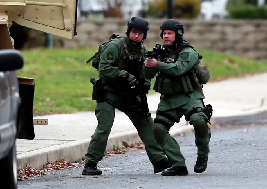 Police surrounded a home in Souderton, Pa., where they had thought the suspect might be barricaded. Photo: Matt Rourke, STF / AP