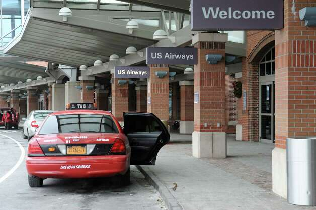 A taxi is seen in front of the terminal at Albany International Airport on Monday, Dec. 15, 2014 in Colonie, N.Y.  (Lori Van Buren / Times Union) Photo: Lori Van Buren / 00029861A