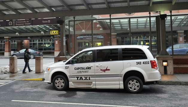 A taxi waits in front of the terminal at Albany International Airport on Monday, Dec. 15, 2014 in Colonie, N.Y.  (Lori Van Buren / Times Union) Photo: Lori Van Buren / 00029861A