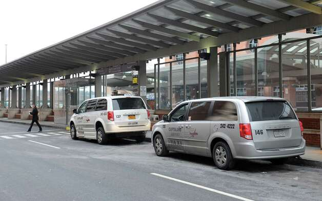 Taxis waits in front of the terminal at Albany International Airport on Monday, Dec. 15, 2014 in Colonie, N.Y.  (Lori Van Buren / Times Union) Photo: Lori Van Buren / 00029861A