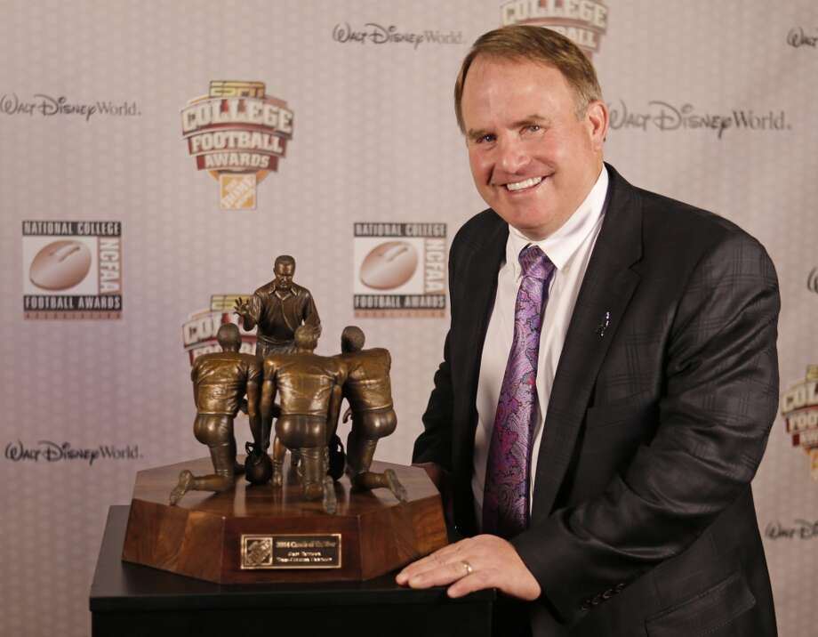 TCU head coach Gary Patterson stands with his trophy after being awarded the Coach of the Year Award at the College Football Awards, Thursday, Dec. 11, 2014, in Lake Buena Vista, Fla. (AP Photo/John Raoux) Photo: Associated Press