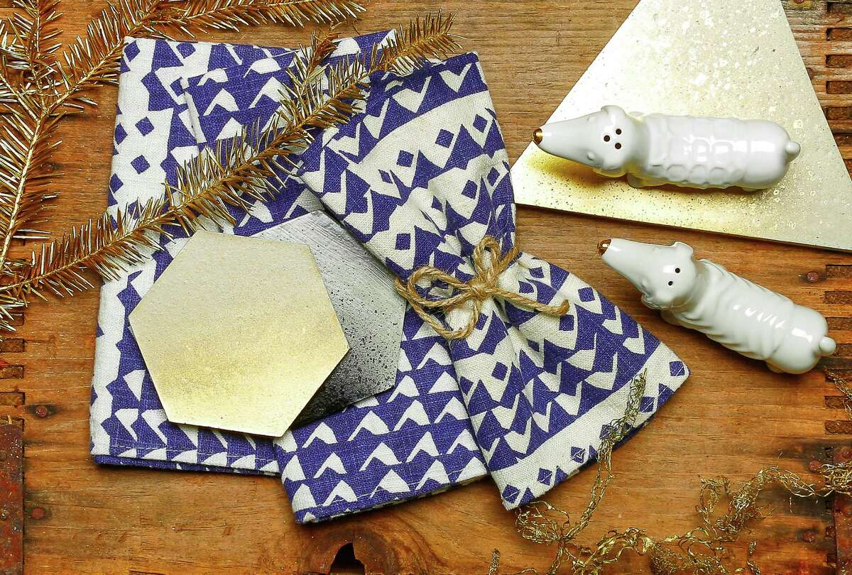 Shake it up with shapes and textures: 45 Wall Design concrete trivet ($19) and coasters ($29 for four), Park and Pond, 1422 Grant Ave., www.45walldesign.com; Jenny Pennywood indigo triangle napkins, $32 for two, www.jennypennywood.com; dachshund salt-and-pepper shaker set, $7.99, Target, 789 Mission St., www.target.com