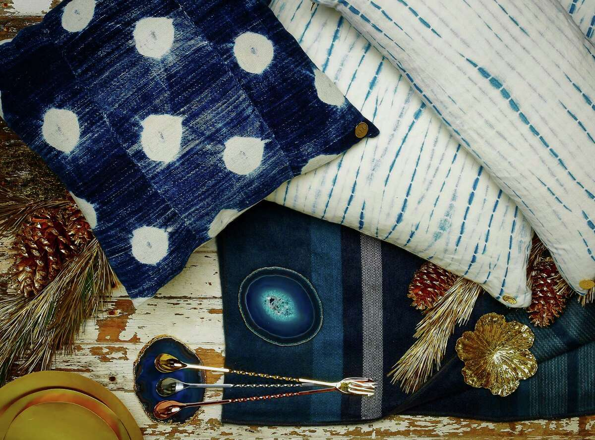 Cool tones kissed with gold: St. Frank modern and vintage indigo pillows, $175-$325, www.stfrank.com; Bahia agate coasters, $125 for 4, Plantation, 336 Hayes St., www.plantationdesign.com; gold, silver, and copper Japanese bar spoons, $19-$30 each, Cask, 17 Third St., www.caskstore.com; AERIN sculpted flower dish, $125-$195, www.aerin.com