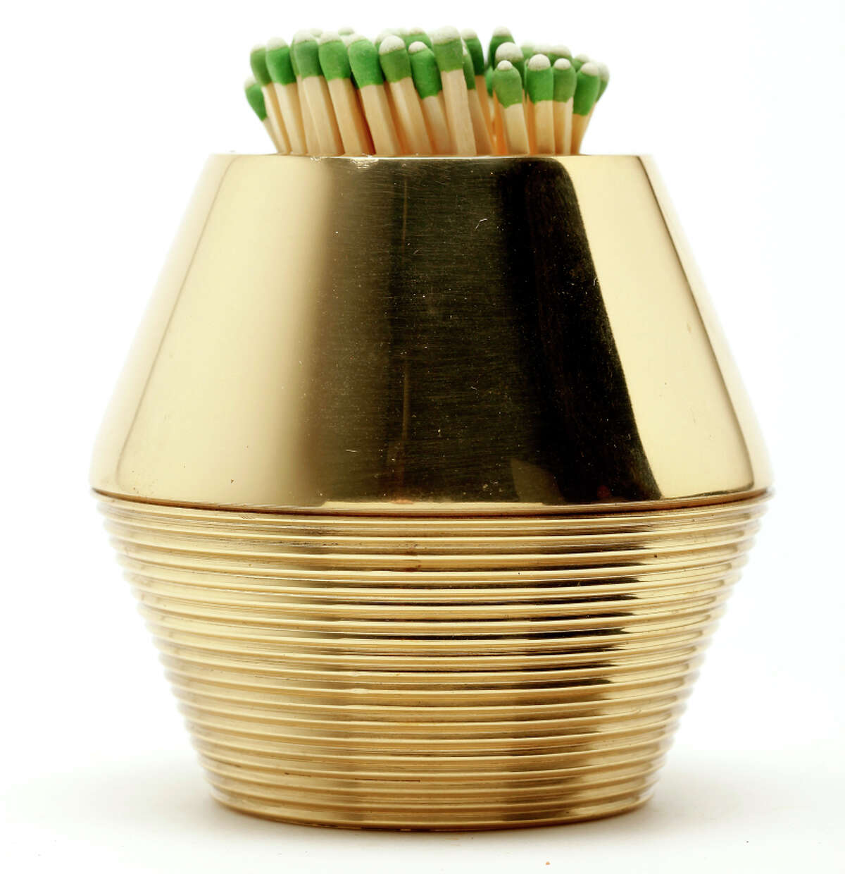 AERIN tapered cone match strike in brass works with strike-anywhere matches. $190, www.aerin.com