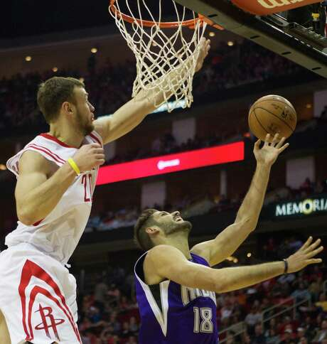The Rockets' Donatas Motiejunas, left, guarding Kings forward Omri Casspi, averaged 14.3 points per game on 56.2 percent shooting when center Dwight Howard was out with a knee injury. Upon Howard's return Saturday night, Motiejunas scored a career-high 25. Photo: Cody Duty, Staff / © 2014 Houston Chronicle