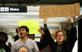 Demonstrators occupy Powell Street BART station in San Francisco, Calif. Friday, December 5, 2014 during a protest against the shooting of Michael Brown in Ferguson, Missouri and the chokehold death of Eric Garner in New York City