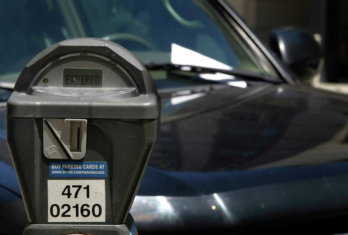 A parking ticket is left on a car parked at an expired meter on Harrison Street in San Francisco on June 28, 2013.