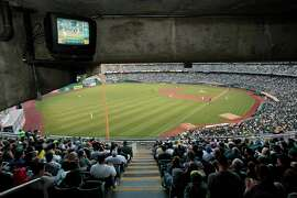 A television shows the game for fans at the Oakland Coliseum on Friday, August 1, 2014 in Oakland, Calif. The Oakland Athletics soon have to find out how to build a new stadium.